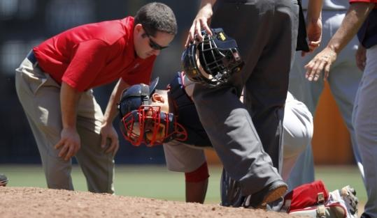 Victor Martinez is checked after he was injured by a foul tip in the second inning. After still another foul tip, the verdict came in: a broken left thumb.