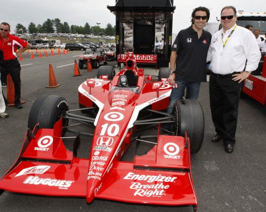 Dario Franchitti (left) and team owner Chip Ganassi with the Indy car that caused a stir before the Lenox Industrial Tools 301.