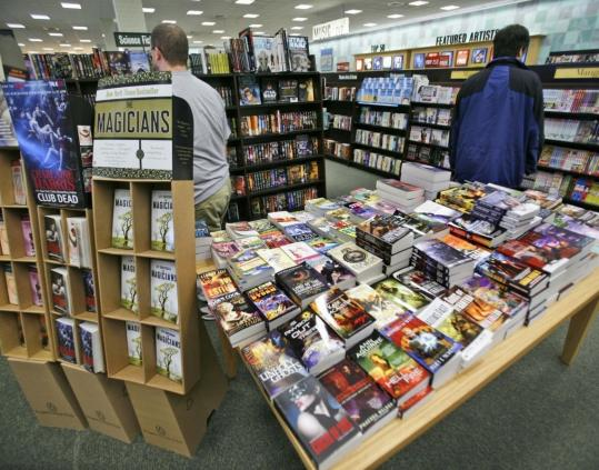 Bookseller Barnes & Noble cited its push into the growing electronic book market as it reported an increased loss in the last quarter. Revenue in stores open at least one year fell 3.1 percent.