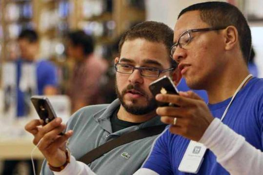 An Apple employee showed a customer some of the features of the iPhone 4 during its launch last week.