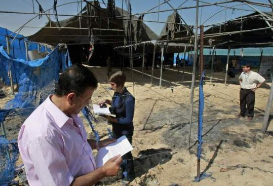 Palestinian employees of the UN relief agency inspected the damage at the camp, which serves about 2,000 children.
