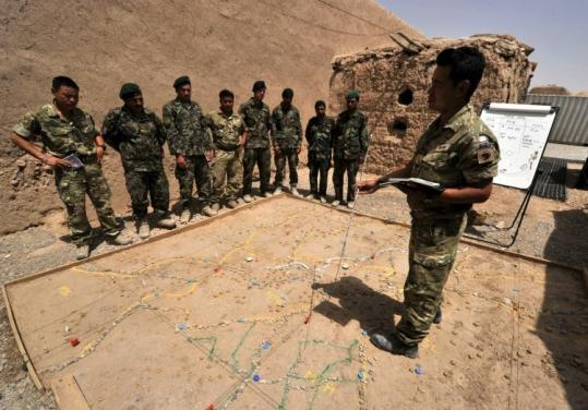NATO force Corporal Bhim Gurung (right) led a training session with Afghan National Army soldiers in Helmand.