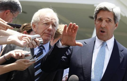 Senator John F. Kerry, with Senator Joe Lieberman, spoke with reporters yesterday after an energy and climate meeting.