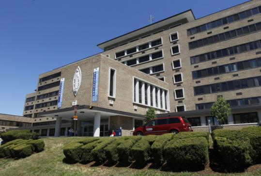 Caritas Carney is one of six hospitals being sold. A group wants the buyer to agree not to sell for five years.