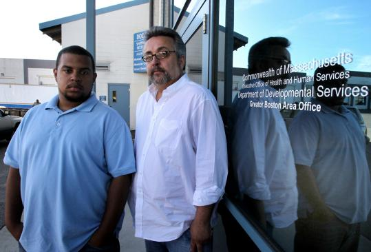 Christopher Jordan (left) and and Alex Arcuri are two human service coordinators expecting to be laid off this week.
