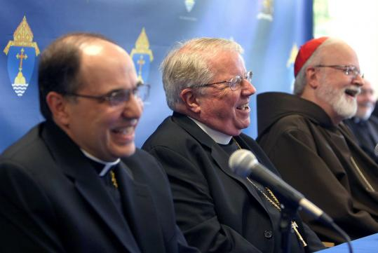 The Rev. Peter Uglietto (left) and the Rev. Arthur Kennedy celebrated their appointment as auxiliary bishops with Cardinal Seán P. O'Malley at the archdiocese's headquarters in Braintree.