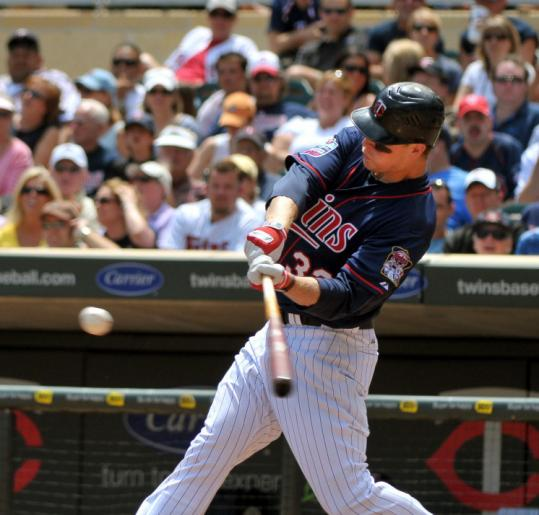 Minnesota first baseman Justin Morneau hits a solo home run in the sixth inning to help the Twins beat Tigers.