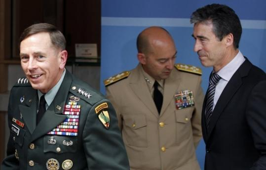 From left, General David Petraeus, newly appointed US and NATO forces commander in Afghanistan; US Navy Admiral James Stavridis, Supreme Allied Commander Europe; and NATO Secretary General Anders Fogh Rasmussen in Brussels yesterday. Aides said Petraeus was to go immediately to Afghanistan.