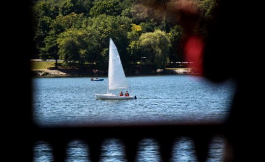 Jamaica Pond offers many pleasures, including sailing, which Christina Close and her husband, Jay, enjoyed Wednesday.