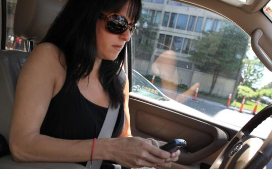 Personal concierge Chantal Boxer, tapping away at a red light, hopes to break her habit of texting while behind the wheel.