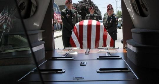 Soldiers from the 27th Engineering Battalion served as pall bearers yesterday for Army Specialist Scott Anthony Andrews.