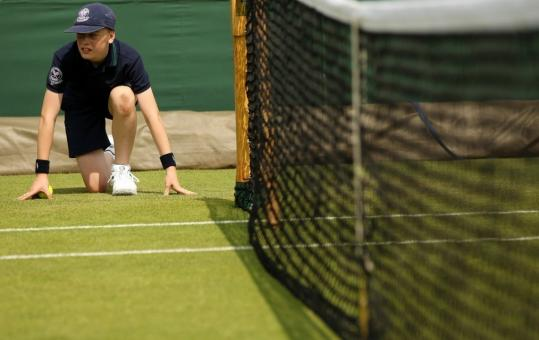 A ball boy looks on, ready to spring into action, during Day 3 of Wimbledon.