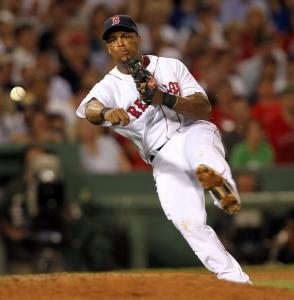 Red Sox third baseman Adrian Beltre adds to the cause by throwing out Julio Lugo at first base in the seventh inning.
