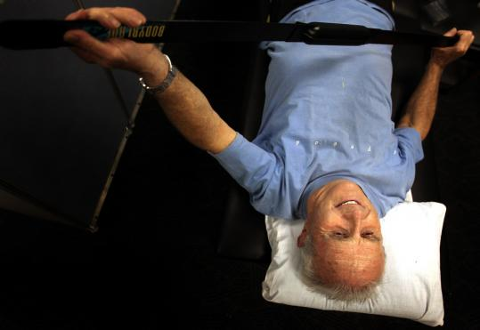 "Robert Shea, 77, does physical therapy to regain mobility in his arm that was injured in a skiing accident. ""I want to live until I die, and I am not anxious to die,'' Shea said."