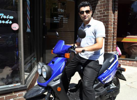 Melhem Berkachi says he was not told his Yamaha Zuma scooter required a license plate when he bought it last week.