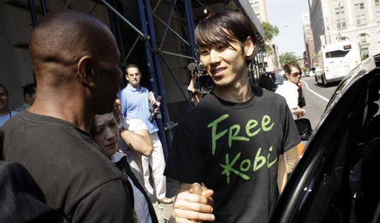 Takeru Kobayashi greeted a supporter outside Brooklyn Criminal Court. His charges included obstruction of governmental administration, resisting arrest, and trespassing.
