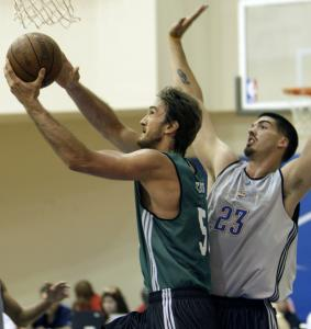 Newly signed Celtics 7-footer Semih Erden shoots in front of the Thunder's Byron Mullens during the second half of a summer league game yesterday.