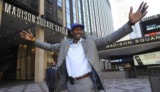 Free agent Amar'e Stoudemire, posing outside Madison Square Garden, will embrace a five-year, nearly $100 million deal with the Knicks.