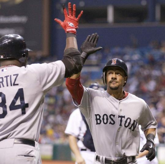 David Ortiz congratulates Eric Patterson after Patterson slugged his second home run.
