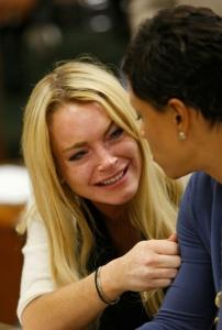 Lindsay Lohan (with lawyer Shawn Chapman Holley) bursts into tears.