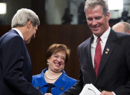 Elena Kagan, nominee for the Supreme Court, smiled after Senators John F. Kerry and Scott Brown introduced her at her confirmation hearing.