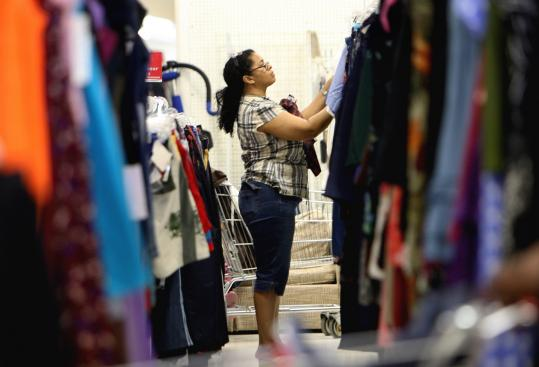 Juana Vargas of Mattapan browsed through the clothing racks at the Savers in West Roxbury, which will be relocating to Dedham in the fall.