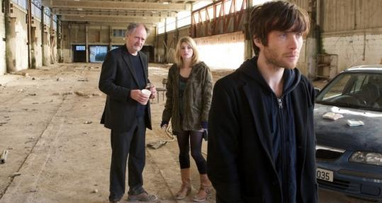 Cillian Murphy (right, with Jim Broadbent and Jodie Whittaker) is pursued over a small debt.