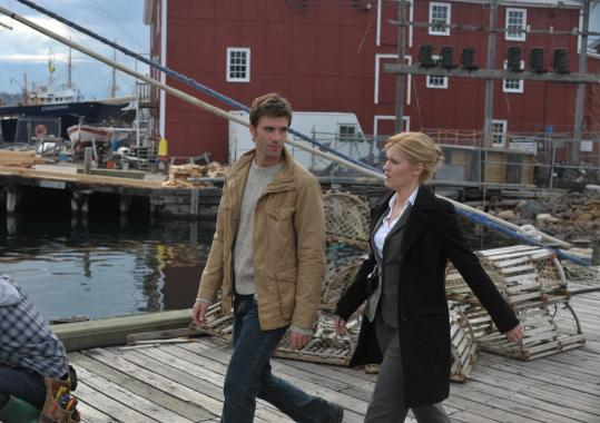 "Lucas Bryant plays a police officer who can feel no pain and Emily Rose a rookie FBI agent in town to investigate a murder in Syfy's new series ""Haven.''"