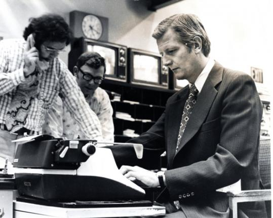 "John Henning on a typewriter at Channel 5 in 1974. ""He asked serious questions,'' former governor Michael Dukakis said."