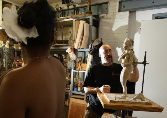 Morris Norvin works on a sculpture at the Stonybrook Fine Arts studio where he is the director and instructor.
