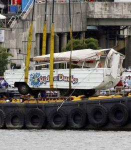 The duck boat was placed on a barge yesterday after it was pulled from the river. The boat sank Wednesday.