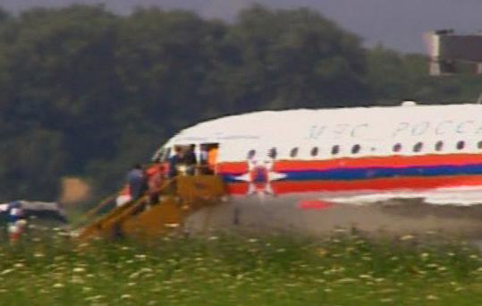 In this image from a TV report, unidentified people climbed the steps into a doorway of a Russian plane believed to be involved in yesterday's spy swap at Vienna's international airport.