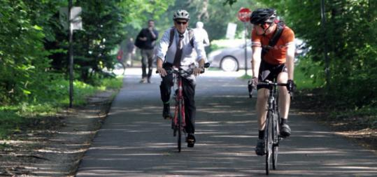 Bicyclists ride on the Minuteman Bike Trail in Arlington.