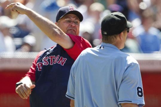Terry Francona mimics umpire Jeff Kellogg after the Sox manager was thrown out of the game following an argument.