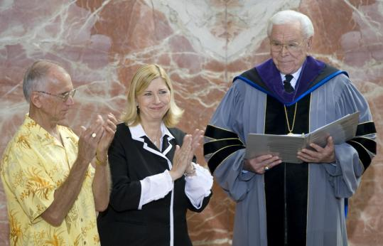 Sheila Schuller Coleman and her husband, Jim, shared applause with congregants at the Crystal Cathedral, as her father Robert H. Schuller, named her senior pastor yesterday.