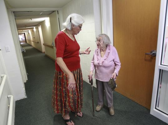 Ellen Feingold (left), president of Jewish Community Housing for the Elderly, chatted with resident Henrietta Greenberg in Brighton.