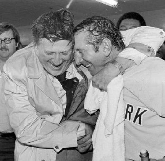 George Steinbrenner, left, and manager Billy Martin are doused with champagne after the Yankees won the 1977 AL championship.
