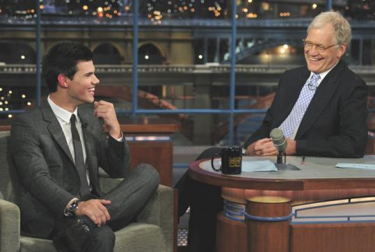 John paul filo/associated press/file David Letterman (interviewing Taylor Lautner last month) has seen viewership for his CBS talk show slip by 7 percent since last year.