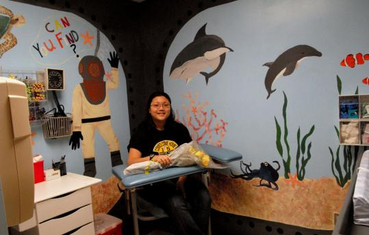 Winchester artist paints mural for hospital s pediatric for Blood in blood out mural