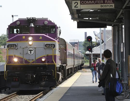 MBTA commuter rail lines, including this one in Framingham, are prone to service delays. Officials say 20 new locomotives will allow the transit agency to retire many of its aging locomotives, which are blamed for about half the delays on the rail lines.