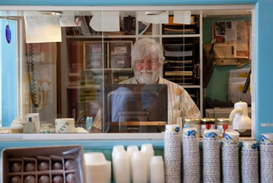 Steve Herrell works in his office above his Northampton ice cream shop.