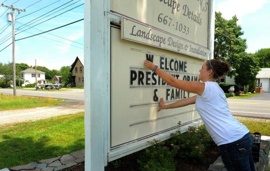 Nicole Bennett put up a welcome message for the Obamas outside a business yesterday in Trenton, Maine.