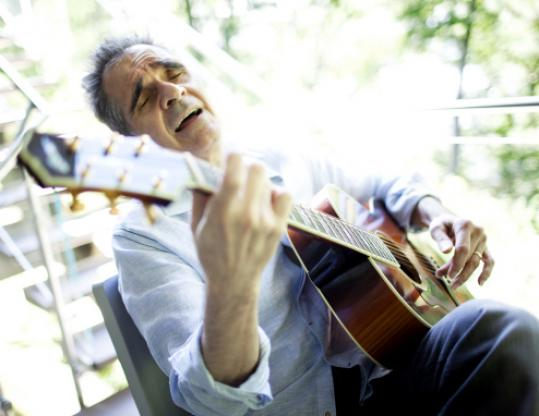 Bob Davoli sang an original work Thursday on a deck outside his custom-built home in Lincoln.