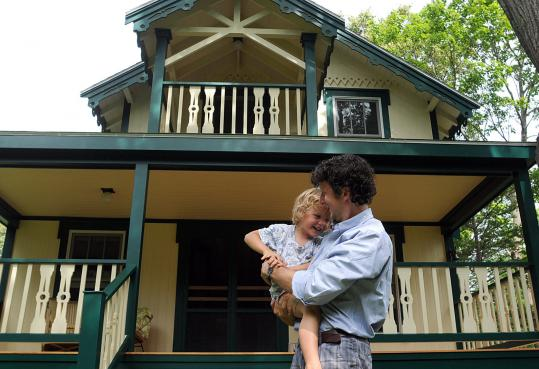 The Currier family has summered in this Victorian cottage for six generations. James Currier (above), with son Bodie, recently had the home restored, using old photos as a guide.