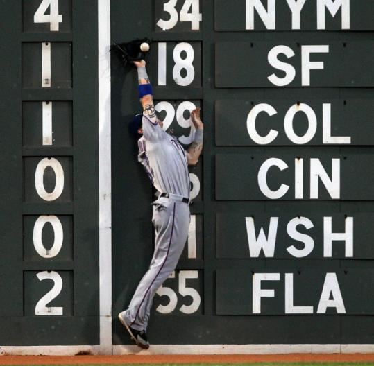 The Rangers' Josh Hamilton leaped but was unable to come down with Mike Cameron's double off the wall in the fifth.