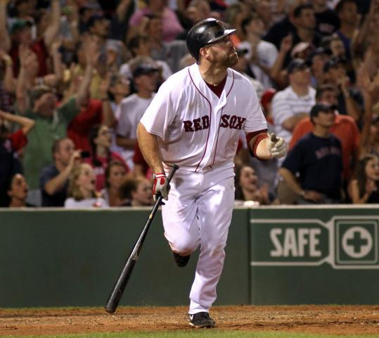 After tying the game in the ninth, Kevin Youkilis follows his winning sacrifice fly in the 11th.