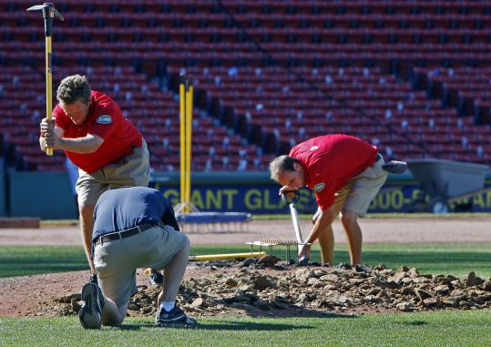 With the Red Sox headed out of town, and soccer coming to Fenway Park later this week, the grounds crew gets busy after the game chopping up the mound.