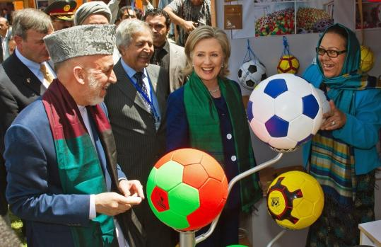 President Hamid Karzai toured a crafts bazaar in Kabul, Afghanistan, with US Secretary of State Hillary Rodham Clinton.