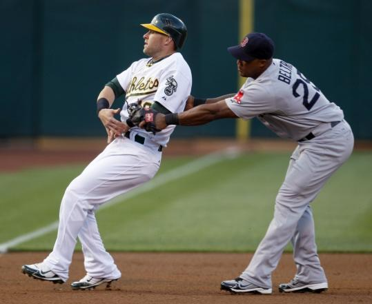Sox third baseman Adrian Beltre tags out Oakland's Daric Barton to end the first last night.