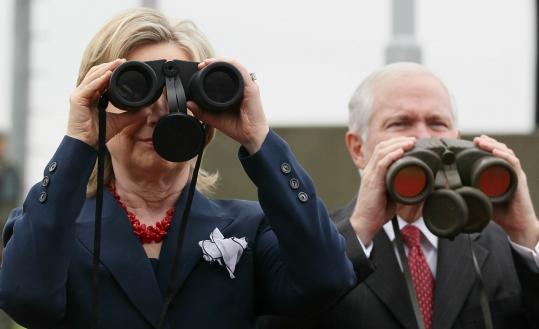 Secretary of State Hillary Rodham Clinton and Defense Secretary Robert M. Gates looked north yesterday from the DMZ.
